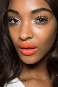 Dark Skinned Woman Wearing an Orange Lipstick