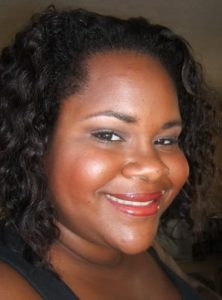 Dark Skinned Woman Wears MAC Hot Tahiti Lipstick
